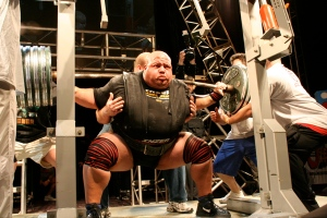 Equipped powerlifter squatting